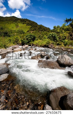A fresh water stream in the mountains - stock photo