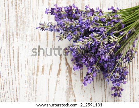 A freshly cut bunch of Lavender, on a rustic white bench