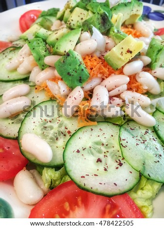 A freshly made organic salad on a plate