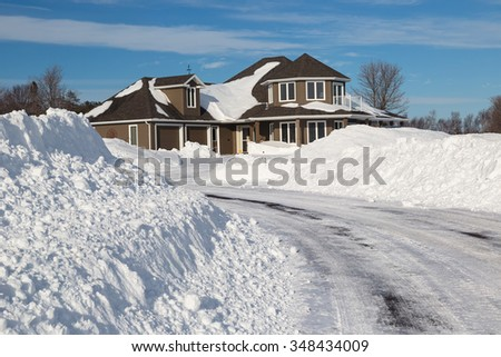 A freshly plowed road in America suburbia after a snow storm.