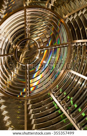 A Fresnel lens  is a type of compact lens used for lighthouses.  - stock photo