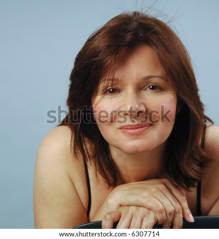 A friendly face above a chair - stock photo