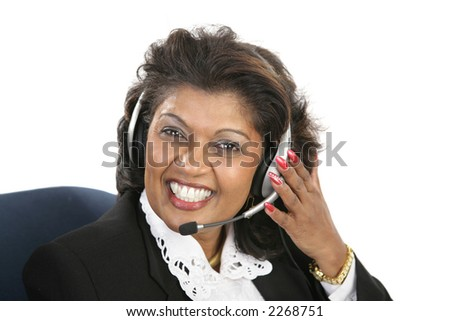 A friendly, Indian customer service agent wearing a headset.  Isolated on white. - stock photo
