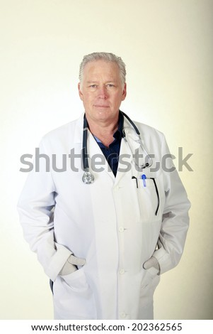A friendly male Doctor, Surgeon or Health Care Professional. The Perfect image for all your Middle Aged Professional Doctor Images - stock photo