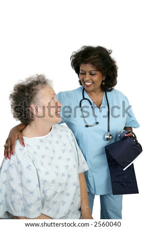 A friendly nurse caring for an elderly hospital patient.  Isolated on white with room for text. - stock photo