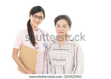 A friendly nurse takes care of an elderly woman