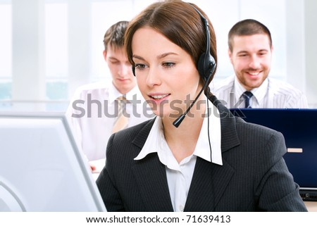 A friendly secretary/telephone operator in an office environment.