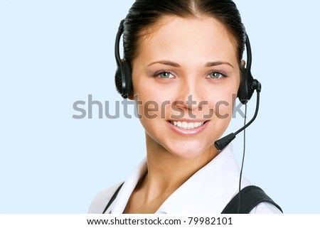 A friendly secretary/telephone operator on the blue background - stock photo