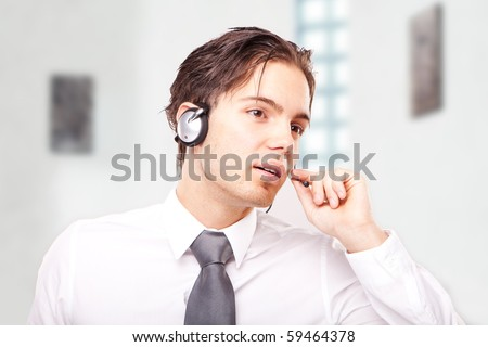 A friendly telephone operator in an office environment. - stock photo
