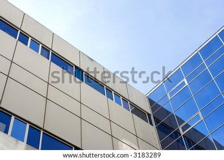 A frogview from a public Builing with reflections in the windows... - stock photo