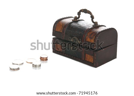 A front studio isolation shot on a white background of a small pirate chest withs some coins.