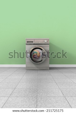 A front view of a regular brushed metal washing machine filled with clothing in an empty room with a shiny tiled floor and a green wall - stock photo