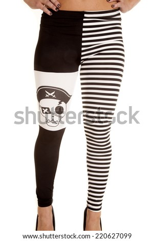 A front view of a woman in her pirate leggings. - stock photo