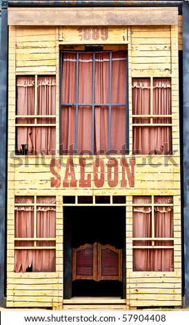 A front view of an old saloon. - stock photo