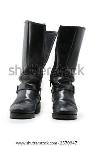 A frontal view of a pair of high women's boots on white background. - stock photo