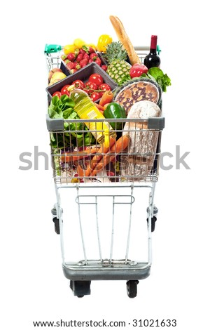 A frontal view of a shopping trolley filled with a selection of fresh food - stock photo