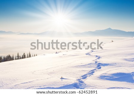 A frosty and sunny day is in mountains - stock photo