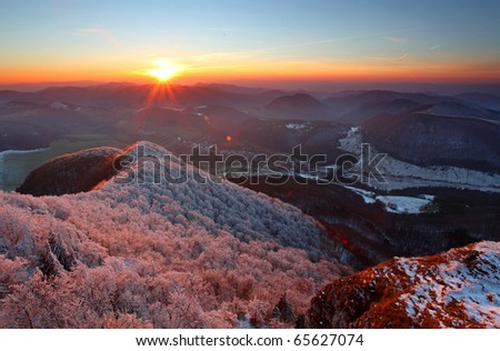 A frosty sunset panorama in beauty mountains from peak Strazov - stock photo