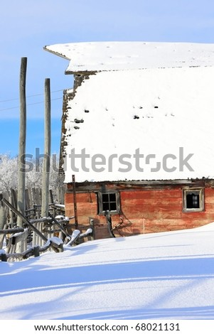A frosty winter wonderland on the prairies where an old barn still stands. - stock photo