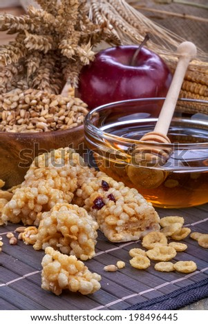 A fruit and nut ceral protein bars with honey and cornflakes - stock photo