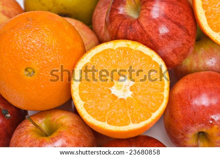 A fruit background of apples and oranges. - stock photo