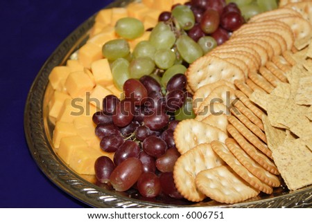 A fruit, cheese and cracker tray. - stock photo