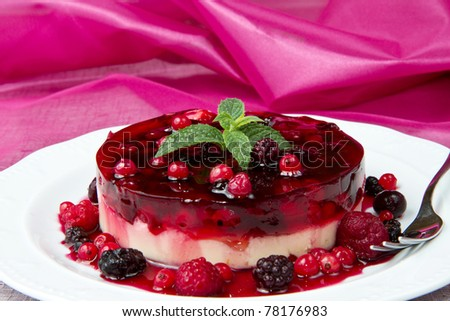 A  fruits tart on a glass cake stand - stock photo