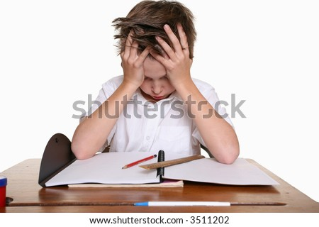 A frustrated, upset child, or child with learning difficulties. - stock photo