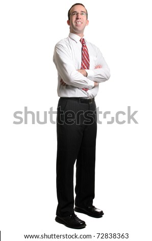A full body view of a young business man looking forward, isolated against a white background - stock photo