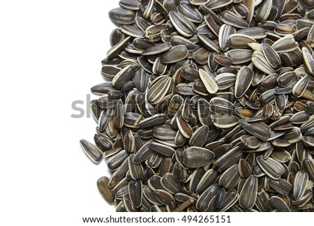 A full crop of sunflower seeds texture isolated on a white background