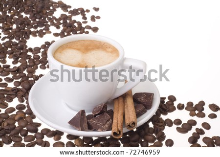 A full cup of fresh espresso coffee with a empty place for your text and some coffee beans./Cup of fresh espresso - stock photo