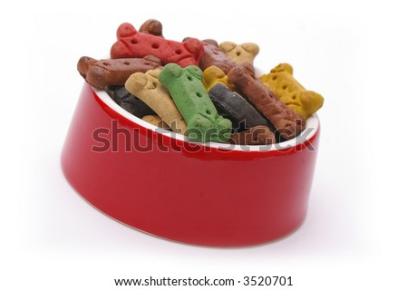 A full dinner of dog treats for a very pampered pooch. - stock photo