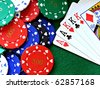 A full house poker hand cards & chips on a green felt table background - stock