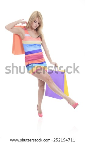 A Full lengh portrait of a beautiful young woman posing with shopping bags, isolated on white background