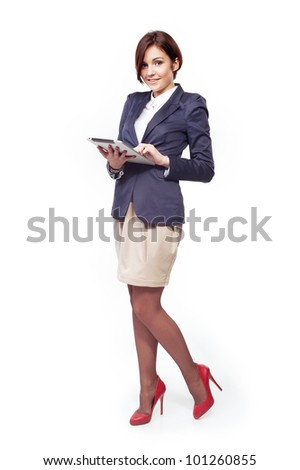 A full length portrait of a beautiful businesswoman with tablet - stock photo