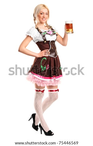A full length portrait of a beautiful woman wearing a traditional costume holding a beer glass isolated on white