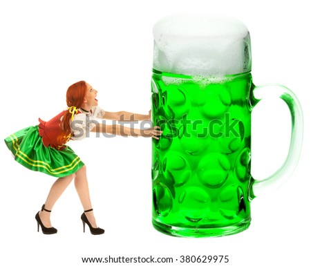 A Full Length Portrait of a Happy Woman Dressed a Traditional St. Patrick's Day Costume Holding a Huge  Green Beer Glass Isolated on White Background - stock photo