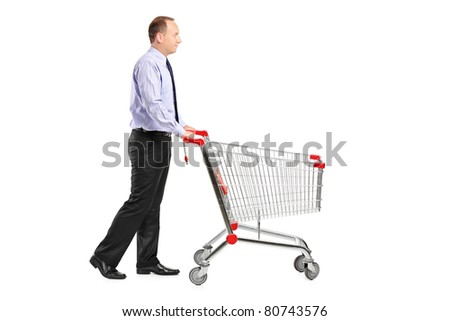 A full length portrait of a man pushing an empty shopping cart isolated on white background - stock photo