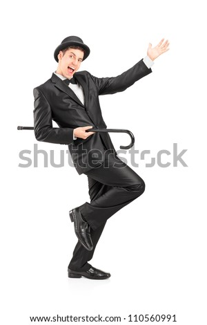A full length portrait of a performer dancing with a cane isolated on white background