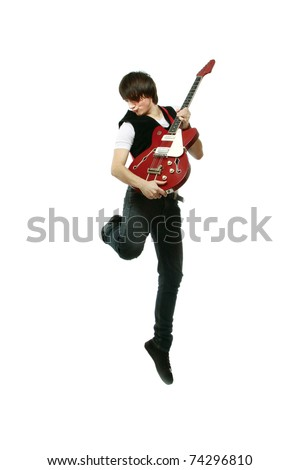 A full-length portrait of a rock guitarist - stock photo