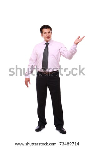 A full-length portrait of a successful businessman showing something - stock photo