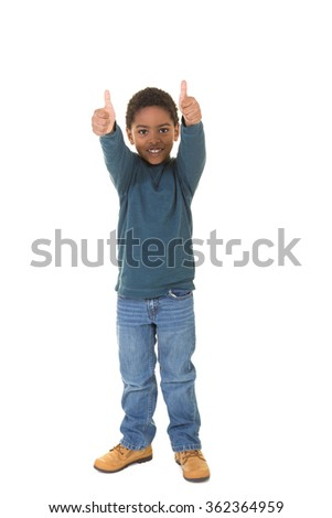 A full length portrait of a young boy isolated on white - stock photo
