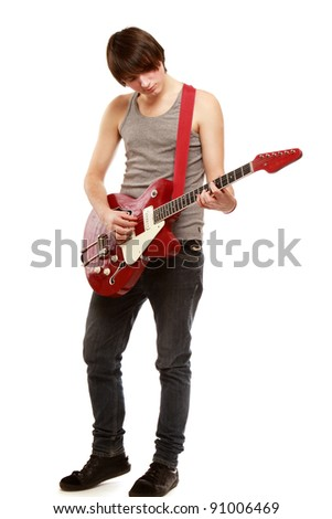 A full-length portrait of a young guitarist , isolated on white background