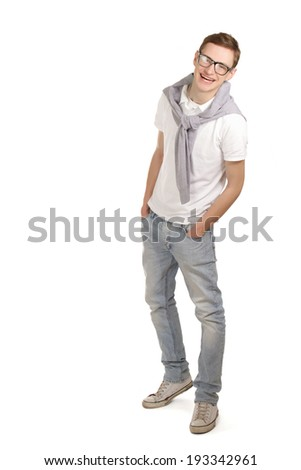 A full-length portrait of a young man, isolated on white background - stock photo