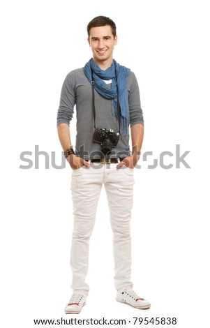 A full-length portrait of a young photographer with a camera, isolated on white - stock photo