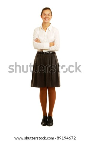 A full-length portrait of a young woman in a white blouse, isolated on white background - stock photo