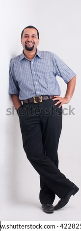 A full length portrait of an Indian man - studio - stock photo