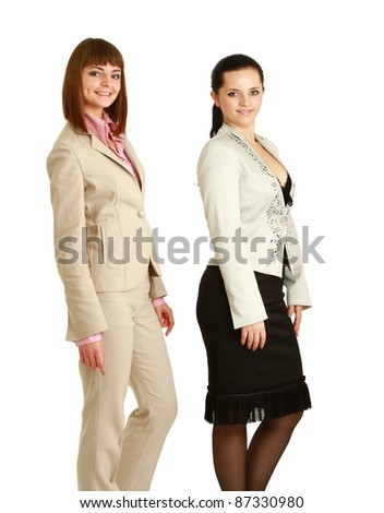 A full-length portrait of businesswomen posing, isolated on white, side-view - stock photo