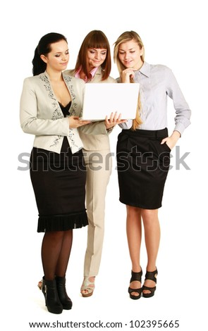 A full-length portrait of businesswomen with a laptop, isolated on white