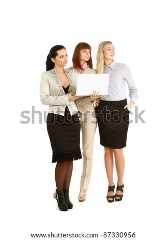 A full-length portrait of businesswomen with a laptop, isolated on white - stock photo